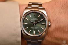 Rolex Oyster Perpetual, steel, olive green dial