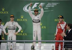 The Lewis Hamilton from Stevenage throws his arms in the air in celebration as beaten Rosberg and Vettel look on from the podium as the British driver becomes Formula 1 World Champion Grand Prix, Red Bull Drivers, Lewis Hamilton Wins, Stevenage, Nico Rosberg, Sports Update, Daniel Ricciardo, Sport Online, 30 Years Old