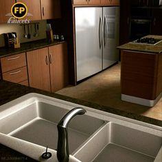 ¿Qué tal llegar a la casa y tener una cocina elegante, práctica y funcional como esta? La madera y los elementos cromados combinan muy bien.  ¡Que no falte nuestra grifería Vulcano...el toque final!