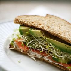 avocado,bean sprout, cucumber,tomato sandwich with light cream cheese on  toasted whole wheat bread=AMAZING.