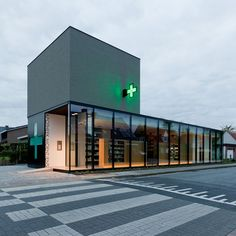 """Pharmacy M was recently completed by Belgian studio Caan Architecten and is situated on the site of a former farm in the outskirts of Ghent. Design Exterior, Facade Design, Interior Exterior, Retail Architecture, Architecture Design, Retail Facade, Flooring Sale, Hospital Design, Clinic Design"