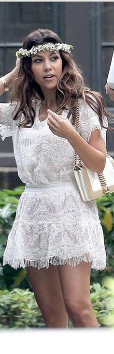 Kourtney Kardashian: Shirt and skirt – Mlle (not available online)  Purse – Chanel