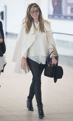 What a beauty! Delta Goodrem grinned from ear-to-ear as she jetted out of Adelaide airport...