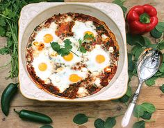 Shakshuka is an Israeli breakfast of eggs poached in thick spicy sauce of onions, peppers and tomatoes. Try this tasty Shakshuka recipe by chef Einat Admony