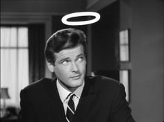 Roger Moore as Simon Templar in the television series, The Saint. ITC. 1963 Mid Atlantic Accent, History Of Television, Dramatic Arts, Celebrity Caricatures, Roger Moore, Popular People, Lone Ranger, Vintage Tv, American Actors