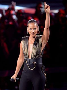Alicia Keys feat Nicki Minaj, ''Girl on Fire''  Keys bowed her new, no-not-actually-Hunger-Games-related single ''Girl on Fire'' (or more accurately, ''Girl on Fiy-ahhhh'') on a relatively unadorned set — just giant matrix-dot dancing ladies projected overhead, and her own gladiatrix-with-a-piano fierceness at the center. Minaj's guest spot was serviceable, but quickly upstaged by little Gabby Douglas.