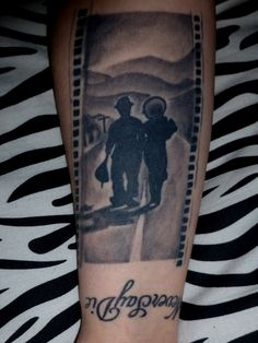 My tattoo on my right forearm of the end scene from Charlie Chaplins film Modern Times. Done by Jef Lessard at Spider Bite in Manchester, NH.
