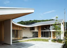Shawl House was designed by Kobe-based Y+M Design Office for a couple with two young children in the southern Japanese city of Imabari, who previously lived in a cramped home with little natural light. It comprises a two-storey house, a separate tea room and terrace, and a carport.