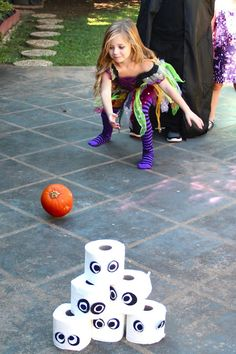 "Fun Halloween Games for Kids - Try Pumpkin Bowling with rolls of ""spooky"" toilet paper!"
