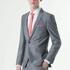 Light grey suit with coral tie