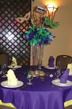 Easy and effective way to decorate for a Mardi Gras party! Use beads and feathers to make a unique centerpiece!