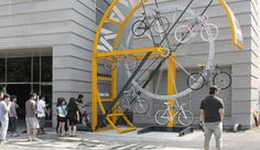 bike hanger project - a bicycle storage facility designed specifically for dense urban areas Bicycle Storage, Bicycle Rack, Urban Furniture, Street Furniture, Furniture Nyc, Furniture Stores, Cheap Furniture, Discount Furniture, Luxury Furniture