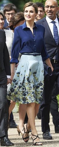 Queen Letizia 2 Jun 2015 - Velazquez exhibition in Paris, France.  For this occasion, Queen Letizia repeated the Carolina Herrera ensemble she debuted last month when she met the Italian president. The outfit consists of the Carolina Herrera Flower Fil Coupe Party Skirt (US$2490), a solid navy silk blouse, Carolina Herrera navy suede strap sandals and Felipe Varela flap clutch.