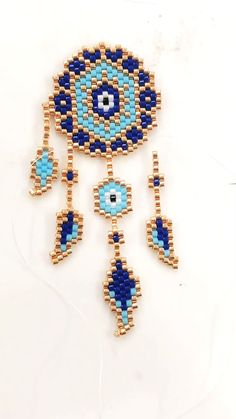 Miyuki Delica Dream Catcher, seed bead pattern, perles, Evil Eye Peyote stitch dream catcher- how to connect pieces together Seed Bead Jewelry, Bead Jewellery, Seed Bead Earrings, Seed Beads, Fuse Beads, Seed Bead Art, Seed Bead Crafts, Hoop Earrings, Beaded Crafts