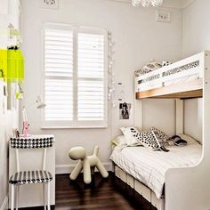 White shared room with accents in black, yellow and pink