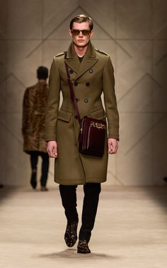 Pale olive cavalry twill greatcoat and leather dégradé satchel on the runway of the Burberry A/W13 Menswear show