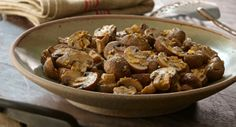 Mushrooms, cooked on the grill in a foil packet, are buttery, tender and flavorful. Serve with grilled meats.