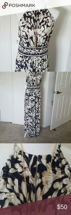 London Times maxi dress NWT London Times maxi dress in floral navy blue and cream! Perfect for island, cruise wear or a wedding! This is a true size 12. 95% polyester and 5% spandex for great stretch! Grecian style that is so flattering! Just too small for me. Chest 20.5 flat and 58 inches long. London Times Dresses Maxi