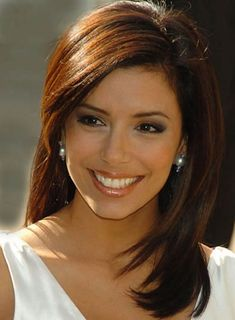 Eva Longoria (One evening, I was out at a bar and I swear, 5 people came up to me that night and said I looked like Eva Longoria! Must've been the layered hair. I can only wish I was as pretty and petite as she is!)