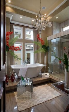 42 Inspiring Tropical Bathroom D?cor Ideas : 42 Amazing Tropical Bathroom D?cor Ideas With White Brown Bathroom Wall Window Curtain Chandelier Bathtub Towel Shower Mirror Glass Door Carpet Flower Decor And Hardwood Floor Dream Bathrooms, Beautiful Bathrooms, Luxury Bathrooms, Hotel Bathrooms, Master Bathrooms, Small Bathrooms, Style At Home, Tropical Bathroom Decor, Bathroom Inspiration