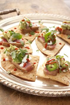 seared tuna with guacamole on baked flour tortilla chips