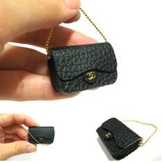 mini Chanel bag...texture=impressively reminiscent of the real deal. so cool