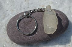 Genuine frosted sea glass keychain. Genuine hand wire wrapped frosted sea glass and silver chain key ring for keys. The sea glass is…