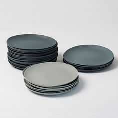 Colour is incorporated into the porcelain before moulding. The plates are unglazed and thus retain their matte, rough surface. Golden Biscotti manufactures the plates in three shades of grey per set of three, which are sold as sets or individually in two different sizes. 