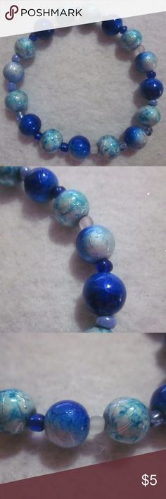 NWOT. Two Tone Bracelet Textured, two tone blue beads. multi seed beads. Stretch. Handmade Jewelry Bracelets