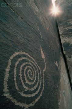 A petroglyph of an Anasazi Indian equinox marker at an archaeoastronomy site in Petrified Forest National Park. Arizona. © Tom Bean/CORBIS