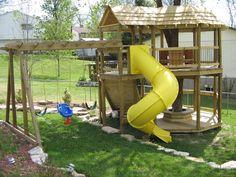 backyard playhouse around the tree