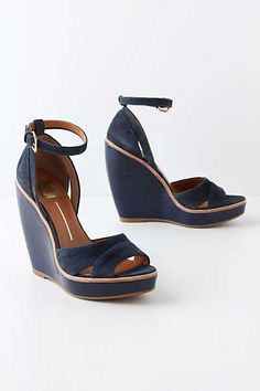 Anthropologie Glossed Groundwork Wedges in navy.