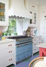 Love The Sky Blue Stove Mixed With Touches Of Rouge Red..and check out the Scalloped Edging On The Vent Hood!
