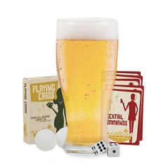 Get the party started with this fun pint of games set Featuring a pint glass, a dealer's deck of playing cards, cocktail commands cards and dice and chips Includes pint glass, deck of cards, booze rules card, dice and chips Imported