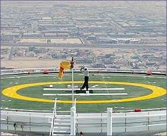 No pressure Tiger: Woods cracks a tee shot from the top of the worlds tallest hotel in Dubai