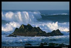 Crashing waves and rocks, Ocean drive. Pacific Grove, California