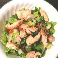 Healthy dinner - salad (romaine lettuce, tomatoes, cucumber, red onion, red pepper (I diced everything but the lettuce)... Dressing - a splash of fresh lemon, a splash of olive oil, a dash of seasoned salt.... Grilled chicken on top. Yummy!!