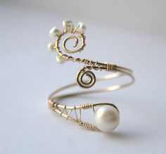 Google Image Result for http://www.deviantart.com/download/288598670/wire_wrapped_ring_with_pearls__giveaway__by_wrappedbydesign-d4rto5q.jpg