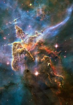 """humanoidhistory: """"A cloud of cold interstellar gas and dust rising from a turbulent stellar nursery in the Carina Nebula, about 7500 light-years away in the constellation Carina, observed by the Hubble Space Telescope on 1-2 February 2010. (ESA) """""""