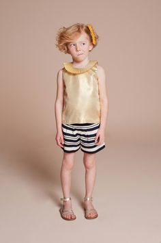 Lame dresses and tops are reprised for summer using gold metallic, a hot trend in kidswear at the moment from Hucklebones for summer 2014