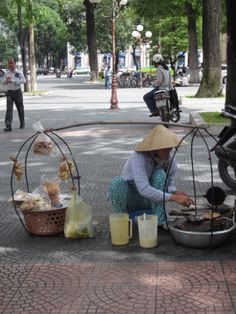 Street vendor in Ho Chi Minh City, Vietnam. In Ho Chi Minh City food stalls line the city's streets, especially around bustling Ben Thanh Market. (V)
