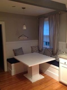 How to make a breakfast nook - Finished project, with cushions! (Too bad the photo is so dark).