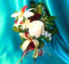 Mother of the Bride Corsage With a Snow White Rose Bud and Orchid Blooms in Pale Lime Green and Burgandy. $22.00, via Etsy.
