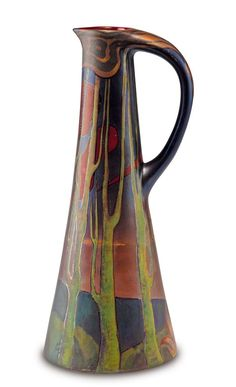 Vilmos Zsolnay, Pécs. Jug, c1900. H. 28 cm. Faience, polychromatic eosin glaze, campfire in front of a wooded landscape at dusk. Marked: Seal, 5574 M 23.