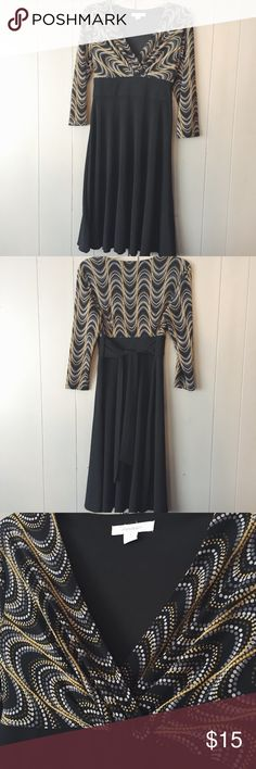 Gorgeous Vneck Dress from DRESS BARN✨ Black, yellow and white pattern up top and black and flowy on the bottom. Belt ties in the back. This dress is like new and in excellent condition! Dress Barn Dresses Midi