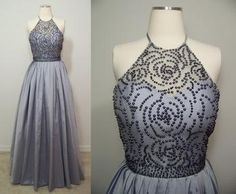 This gunmetal gray, taffeta prom dress features a beaded halter neckline and a-line skirt.