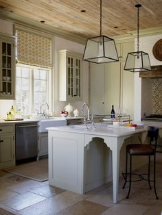 island, pendants, unfinished wood ceiling, floating upper cabinets, farmhouse sink, bridge faucet (Phillip Sides)