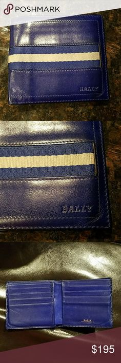 Bally Mens Biofold Royal Blue Woven Stripe Wallet Pre owned in mint condition  A woven stripe strikes through this calfskin Bally wallet. The bifold design contains 8 card slots and a lined, 2-compartment cash pocket. Leather: Calfskin. Measurements Height: 3.75in / 9.5cm Length: 4.25in / 11cm Bally Bags Wallets