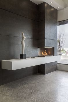 Marble Trend showroom displaying Neolith Iron Moss and Arctic White Satin fireplace. Fireplace Facade, Home Fireplace, Modern Fireplace, Fireplace Surrounds, Fireplace Ideas, Tv Wall Design, House Design, Living Room Decor Fireplace, Contemporary Fireplace Designs