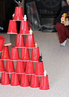 Use Red Cups to create a Nerf Gun Shooting Range - my kids would have a blast shooting the men and cups down.